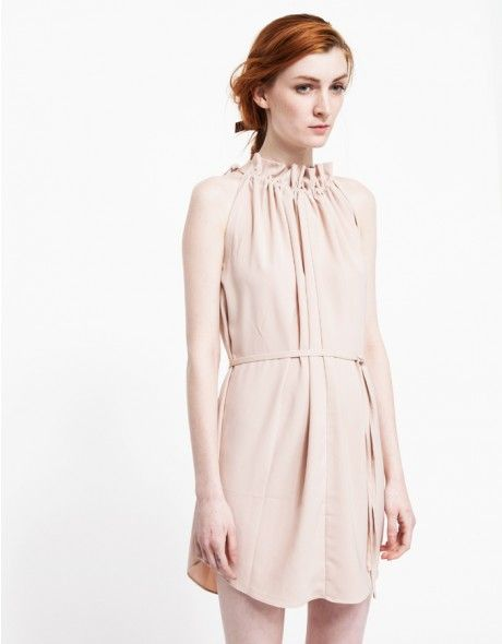 A lightweight, sleeveless dress with modern details. Features a gathered neckline with side tie closures, belted waistline and a relaxed fit through the body.   •Sleeveless dress  •Gathered neckline with side tie closures •Belted waistline •R