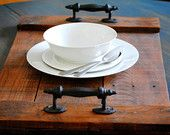 Rustic serving tray hand crafted with reclaimed wood and two cast iron rust handles.