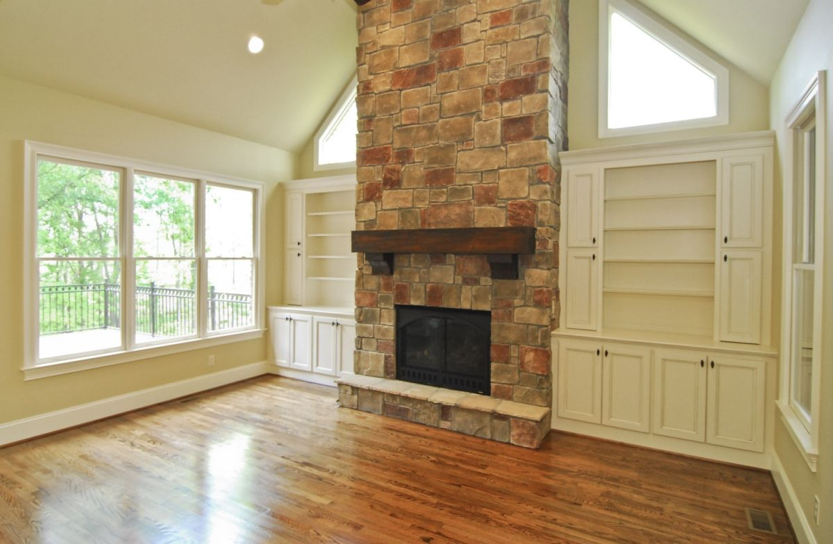 Gorgeous stone fireplace with farmhouse mantle love the white built