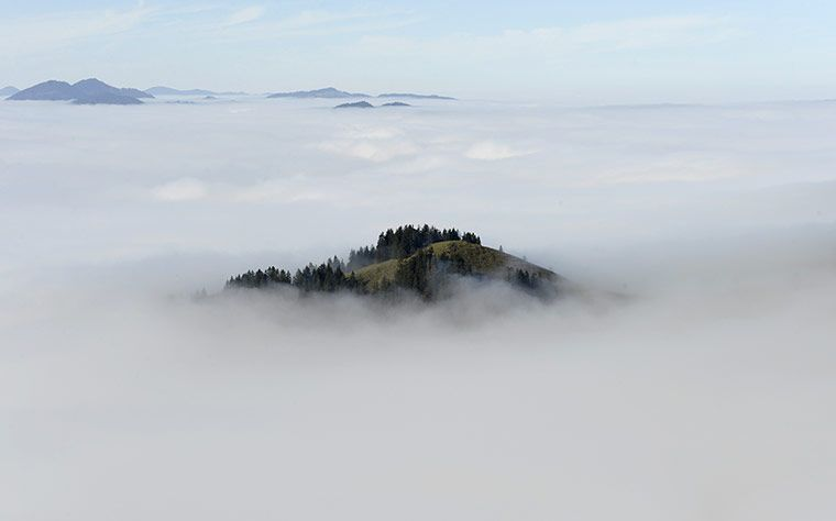 A hillcovered in fog in the Alps near Bayrischzell, Germany
