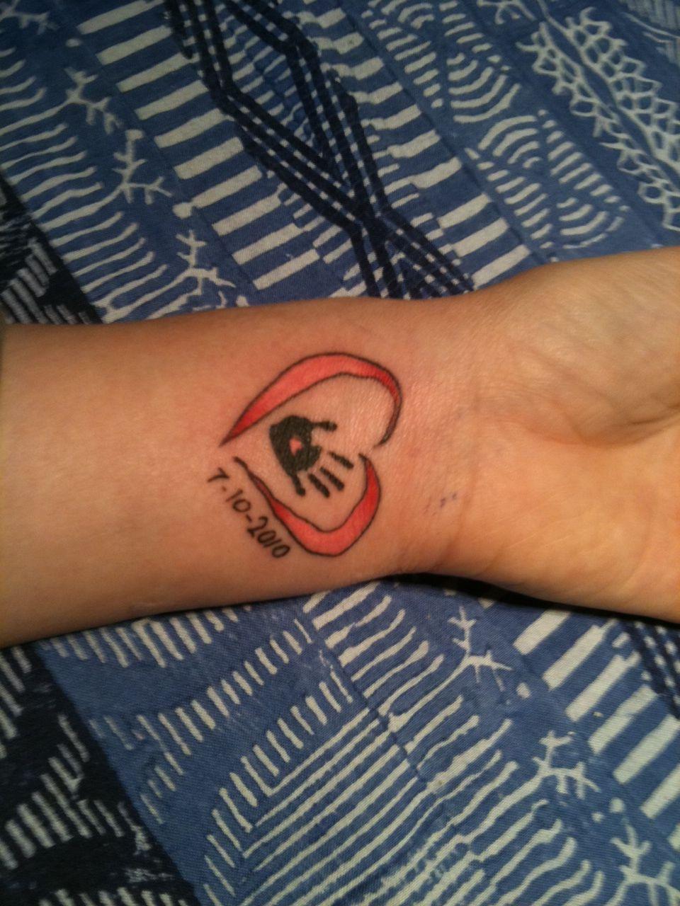 healing hand tattoos like the idea of a child's hand
