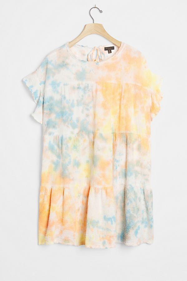 This darling dress features a tie-dyed finish for a refreshing twist.