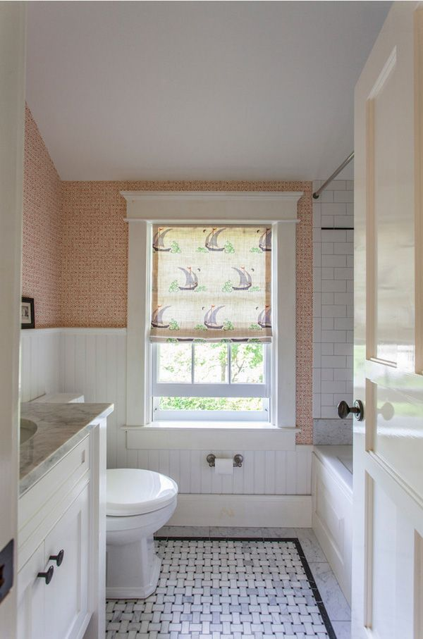 Modern Traditional Bathroom A Bathroom With Orange Wallpaper Subway Tile And Window With A Patterned Roman Shade