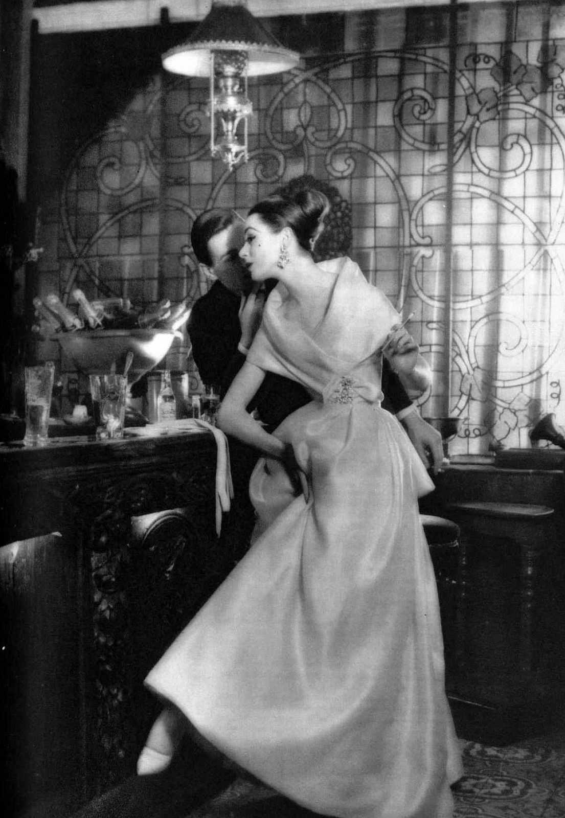 Model (with Robin Tattersall) in pale rose organdy evening gown by Christian Dior, photo by Guy Arsac at the Club du Franc Pinot, Paris, 1957