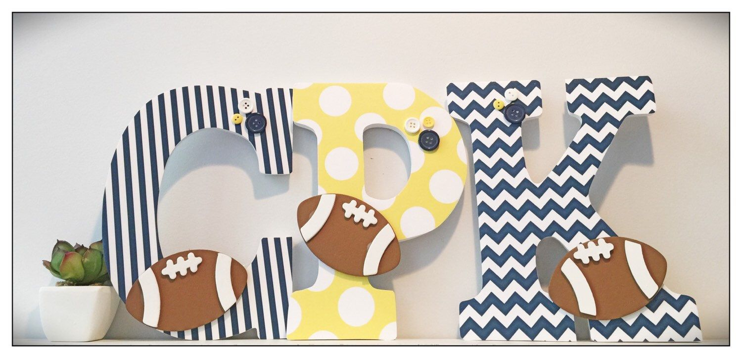 A personal favorite from my Etsy shop https://www.etsy.com/listing/243685021/football-nursery-wall-letters-sports