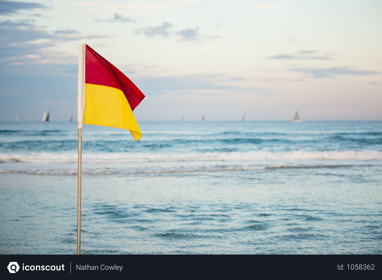 Free Red And Yellow Flag Standing Near Beach Photo Download In Png Jpg Format Red And Yellow Flag Beach Photos Flag Stand