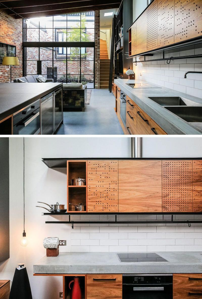 This Industrial Modern Kitchen Features A Concrete Countertop Wood Cabinets And Black Industrial Kitchen Design Modern Kitchen Design Interior Design Kitchen