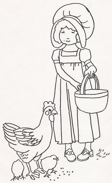 girl feeding chickens1
