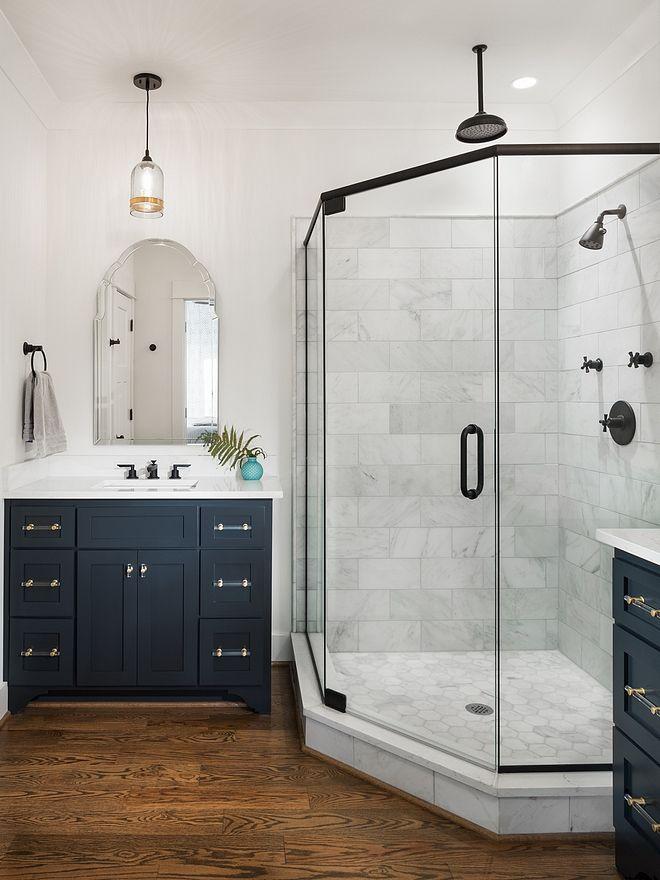 Wood Floor Blue Cabinet Fronts Gold Hardware White Countertop Bathroom Wood Floor Bathroom Farmhouse Shower Guest Bathrooms