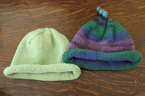 two baby hats
