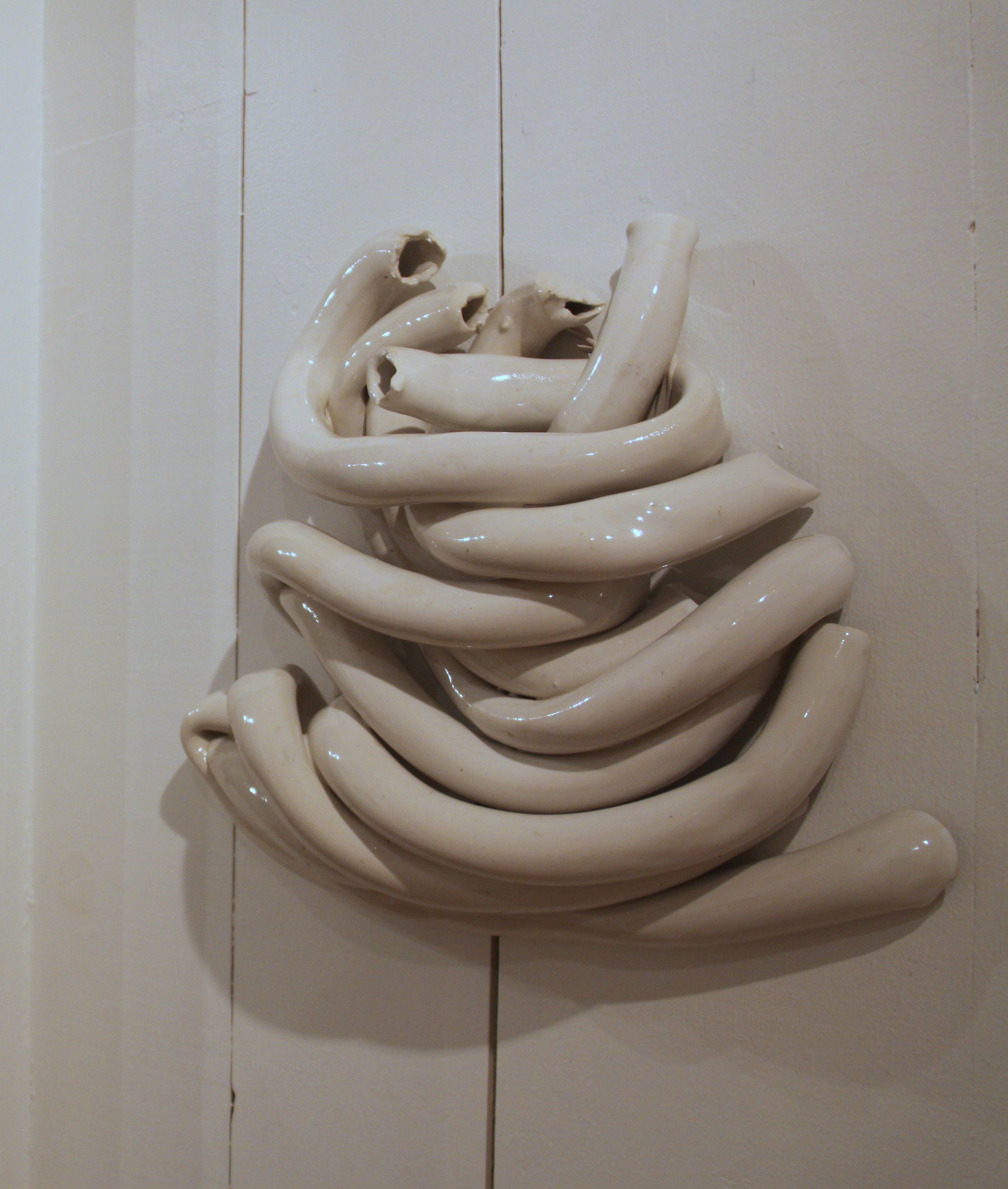 """Dress"" (Mock Battle, No. 1 Series)  Porcelain Wall Sculpture  by Kimberly Kersey-Asbury  Installed at Launch Art, Peterborough, NH"