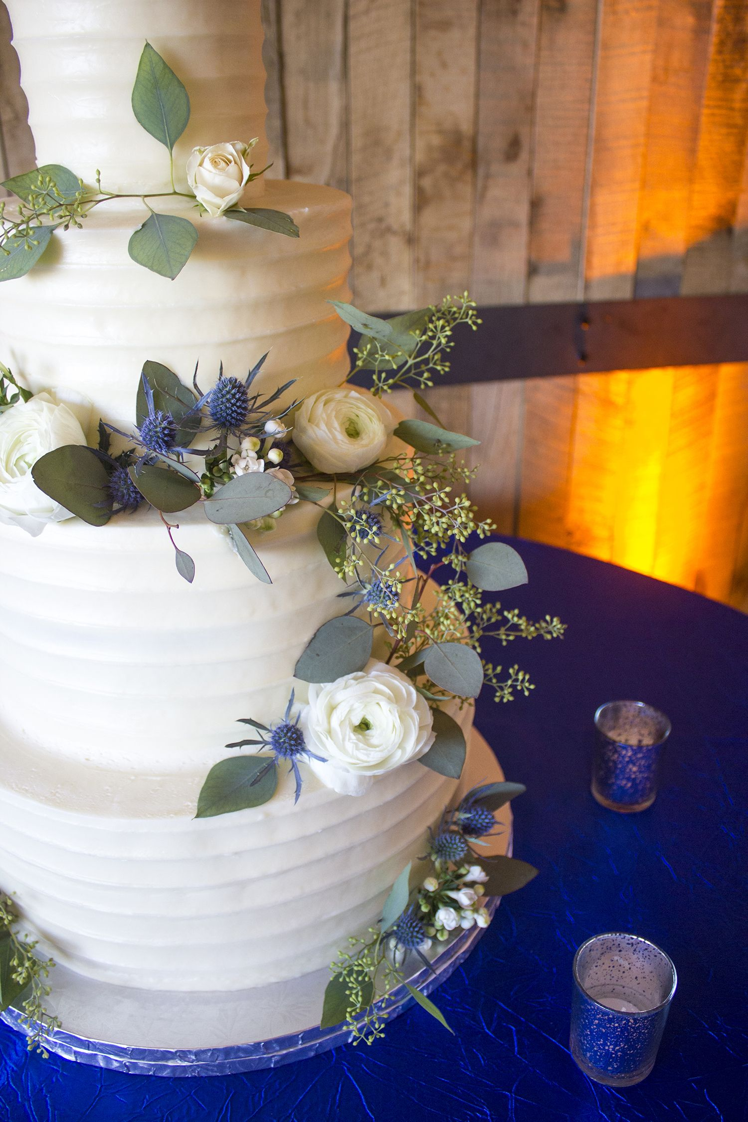 White Ranunculus Blue Thistle And Seeded Eucalyptus For A