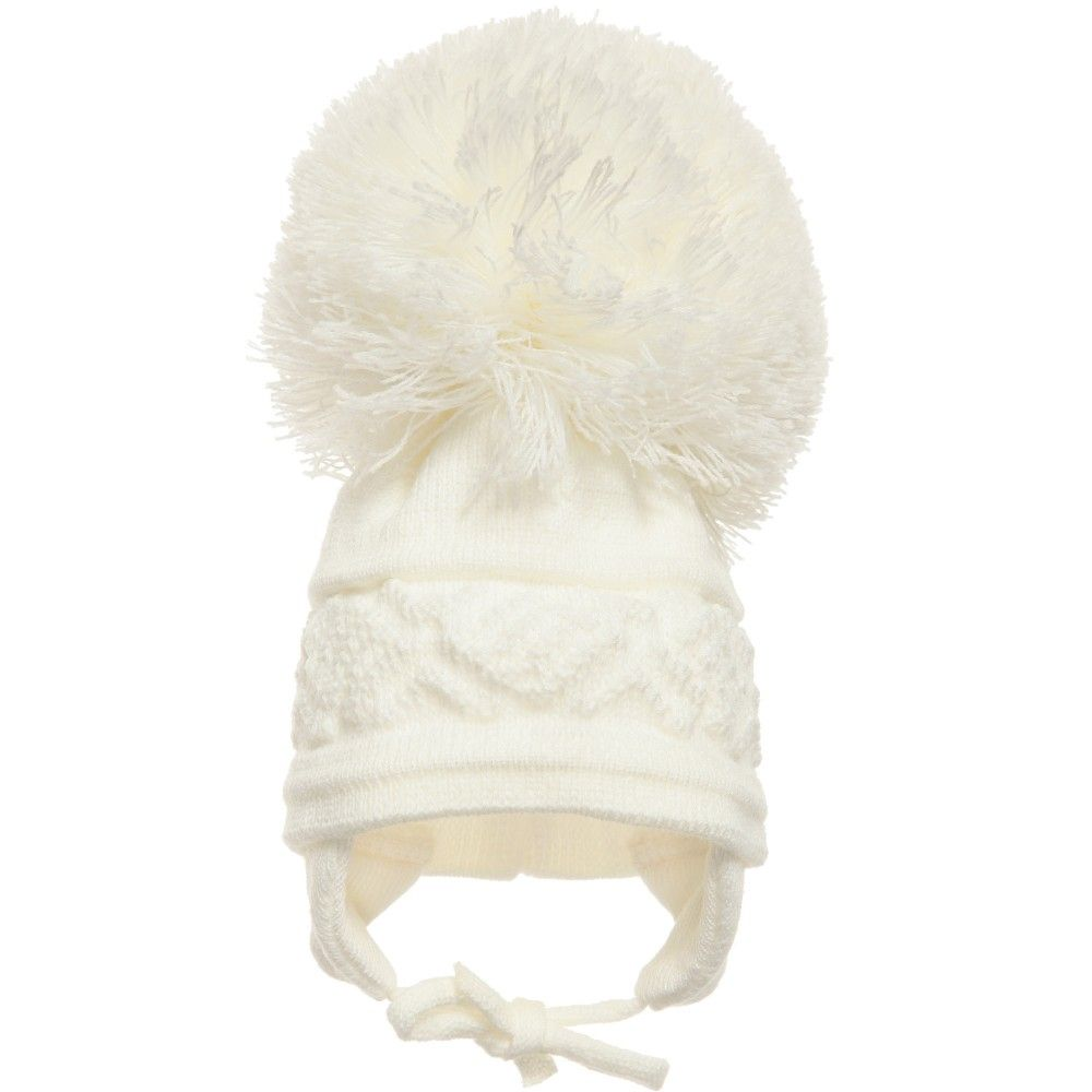 1d07e598d9a Satila of Sweden ivory soft knitted hat with a cable knit diamond design  and large pom-poms on top. It has a half knitted lining adding extra  comfort and ...