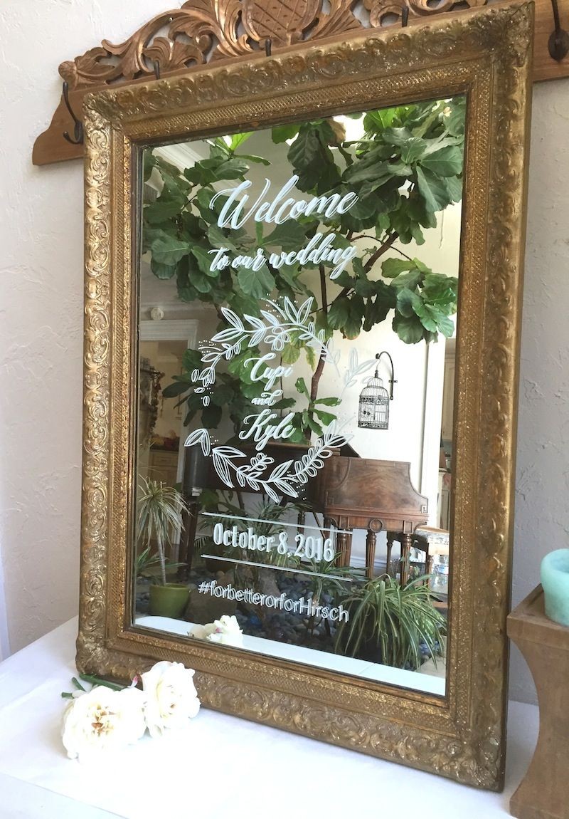 ornate gold framed mirror hand painted as custom wedding welcome