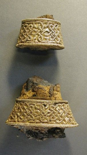 Wide and narrow hilt collars, with remnants of iron sword tang, from a set of 5 gold and garnet sword hilt fittings.  Early Anglo-Saxon, early 7th c.  Market Rasen area, Lincolnshire.  British Museum.