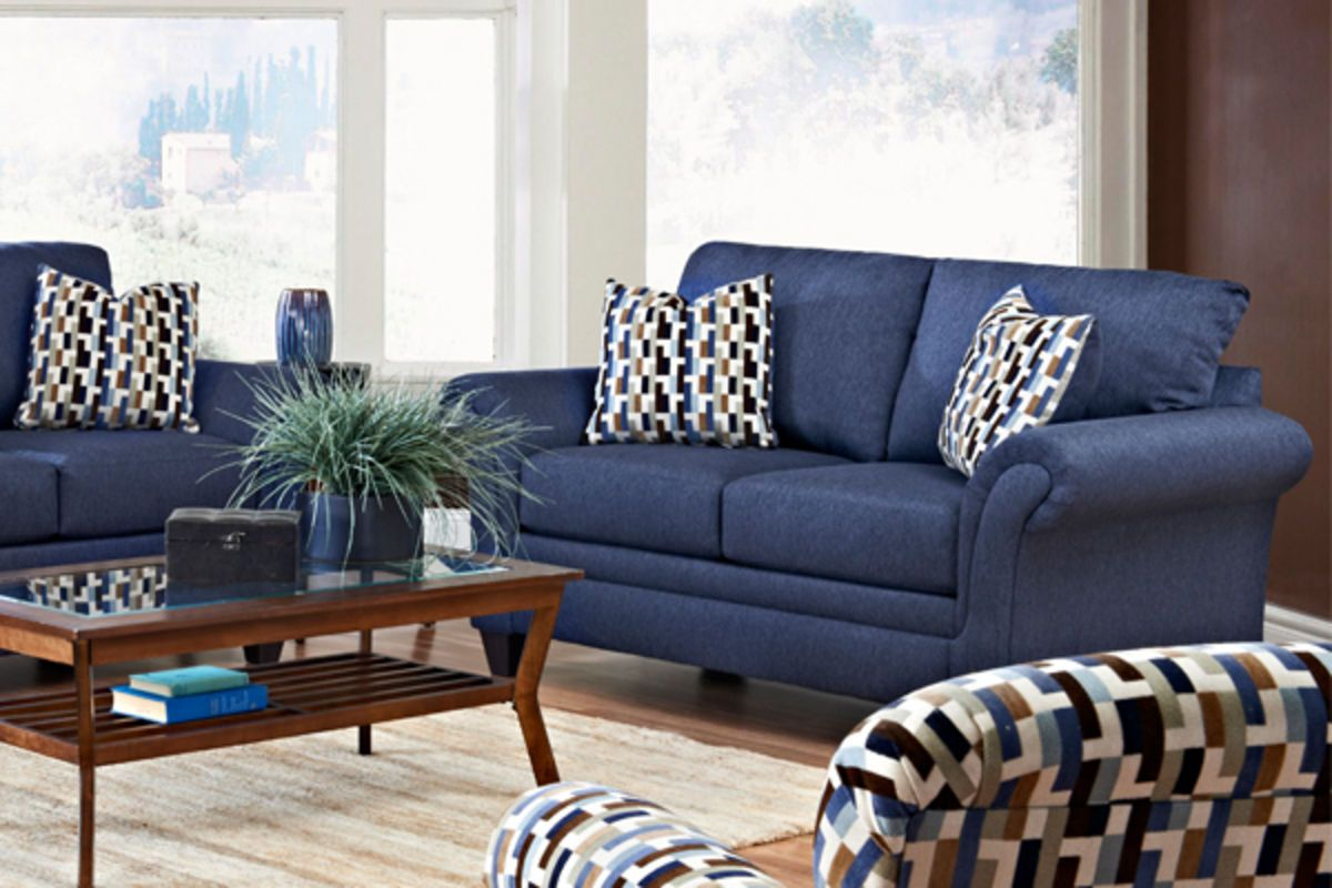 I like this couch. It looks comfortable and it isn't too big. I am digging navy couches right now. I think it would be nice with a rug and a cute patterened accent chair on the side, like pictured.