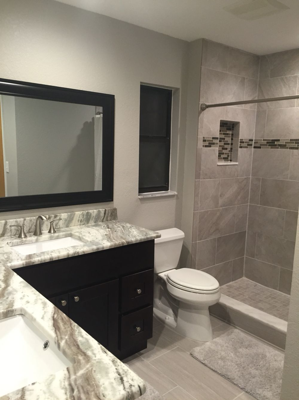 Bathroom remodel in greige tones brown fantasy granite for Brown tile bathroom ideas