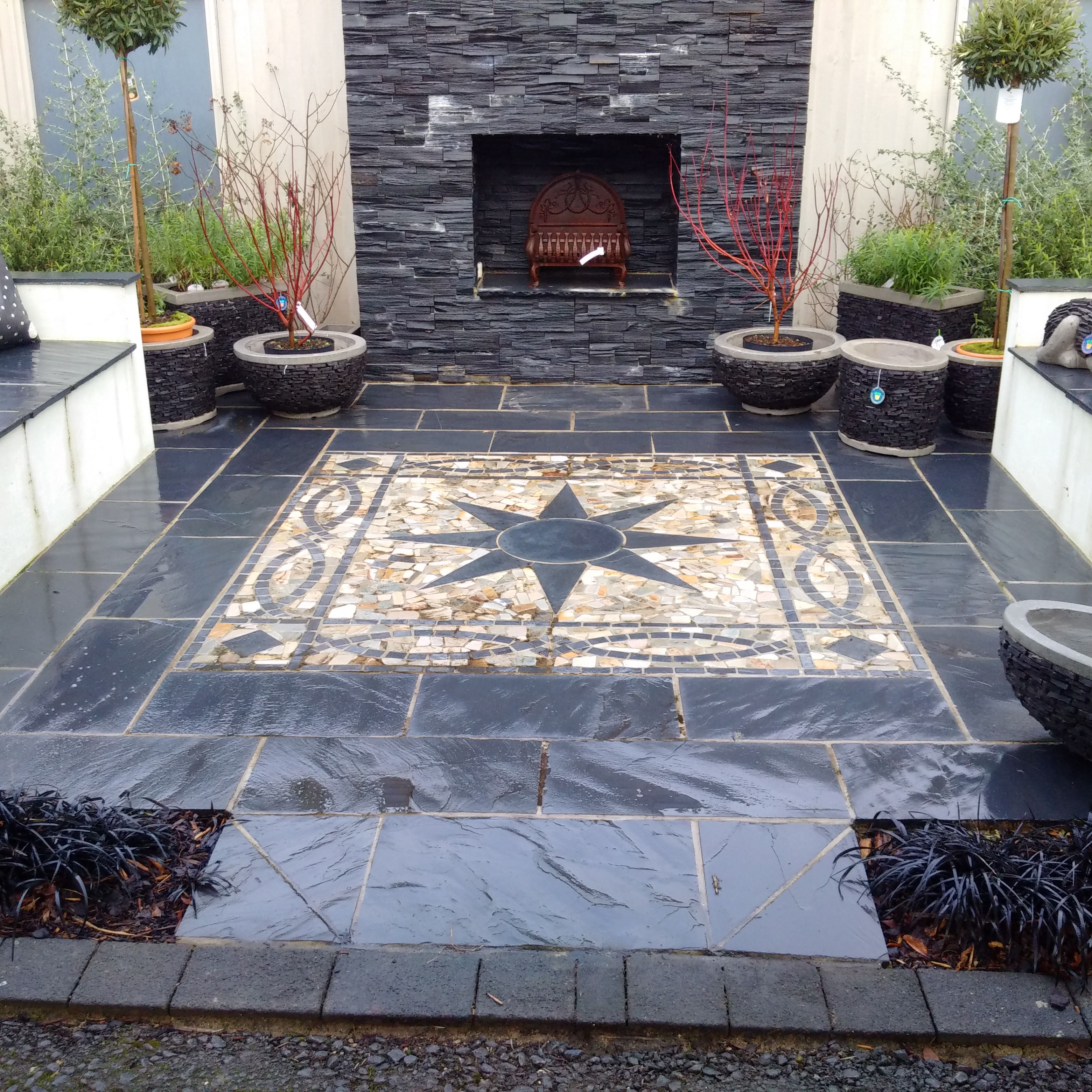 Star Mosaic And Black Slate Paving In One Of Our Garden Destination Centre Show Gardens In Hampshire Www Hambr Outdoor Living Areas Slate Paving Outdoor Decor