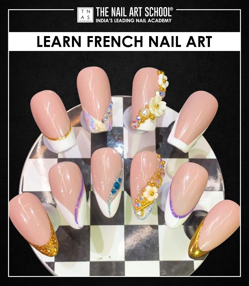 French manicure is a classic nail art design that never goes out of style.✨ Learn how to create Designer French Nail Art  and practice your nail art skills and experiment with different designs at The Nail Art School. Academy at - Mumbai   Bengaluru   Kolkata  #FrenchNailArt #NailArtCourses #NailArt #Nails #NailArtDesign #NailTechnicians #nailtrends #LearnNailArt #NailCourse #DIY #NailPro #NailTechnician #NailExtensions #Learn #Enrol #gelpolish #nailpolish #GLAMNailProduct #RNailLounge