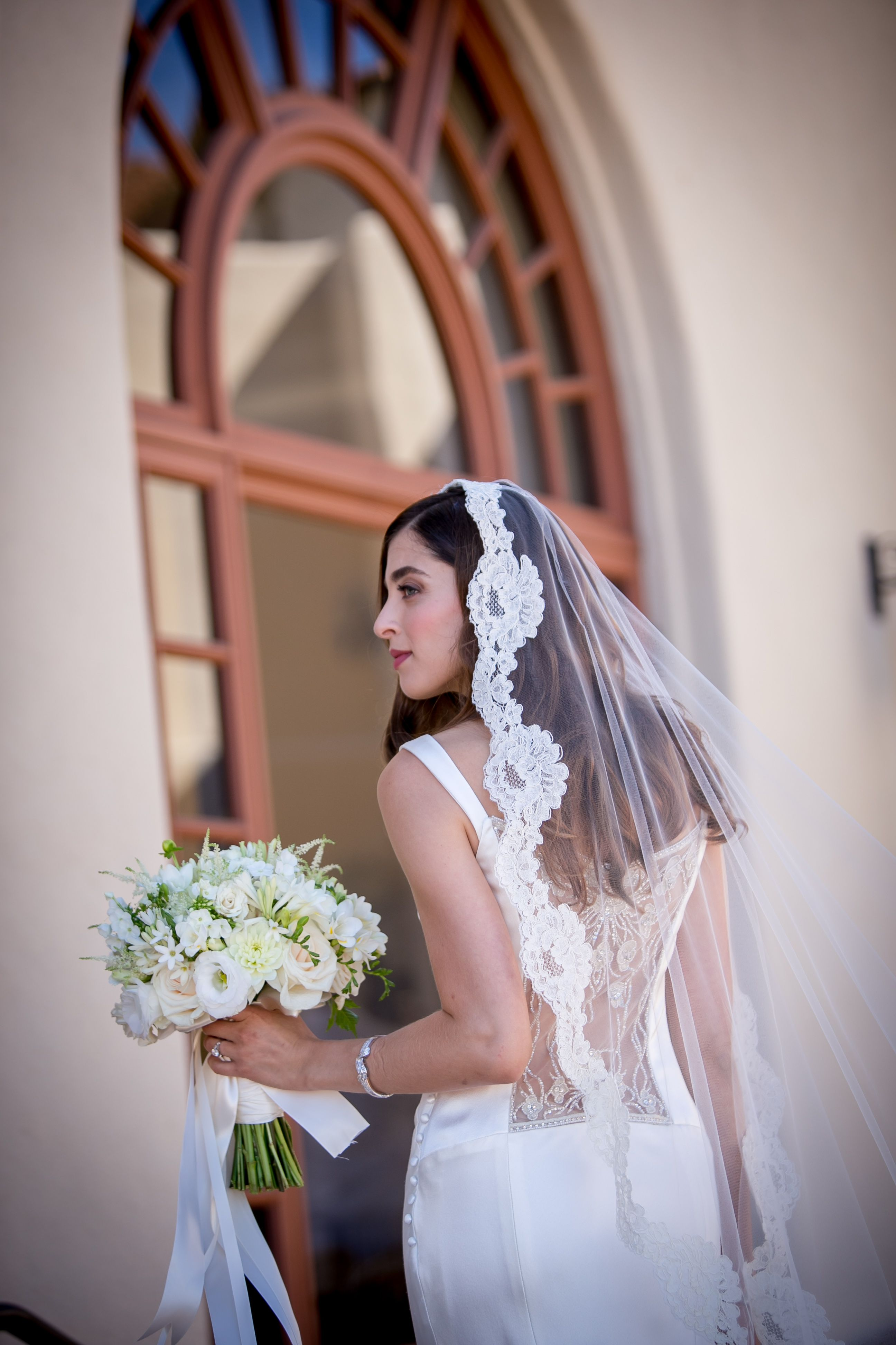 Amy's wedding dress  Flowers by Blossom Floral Inc Photograph by Michael Brannigan