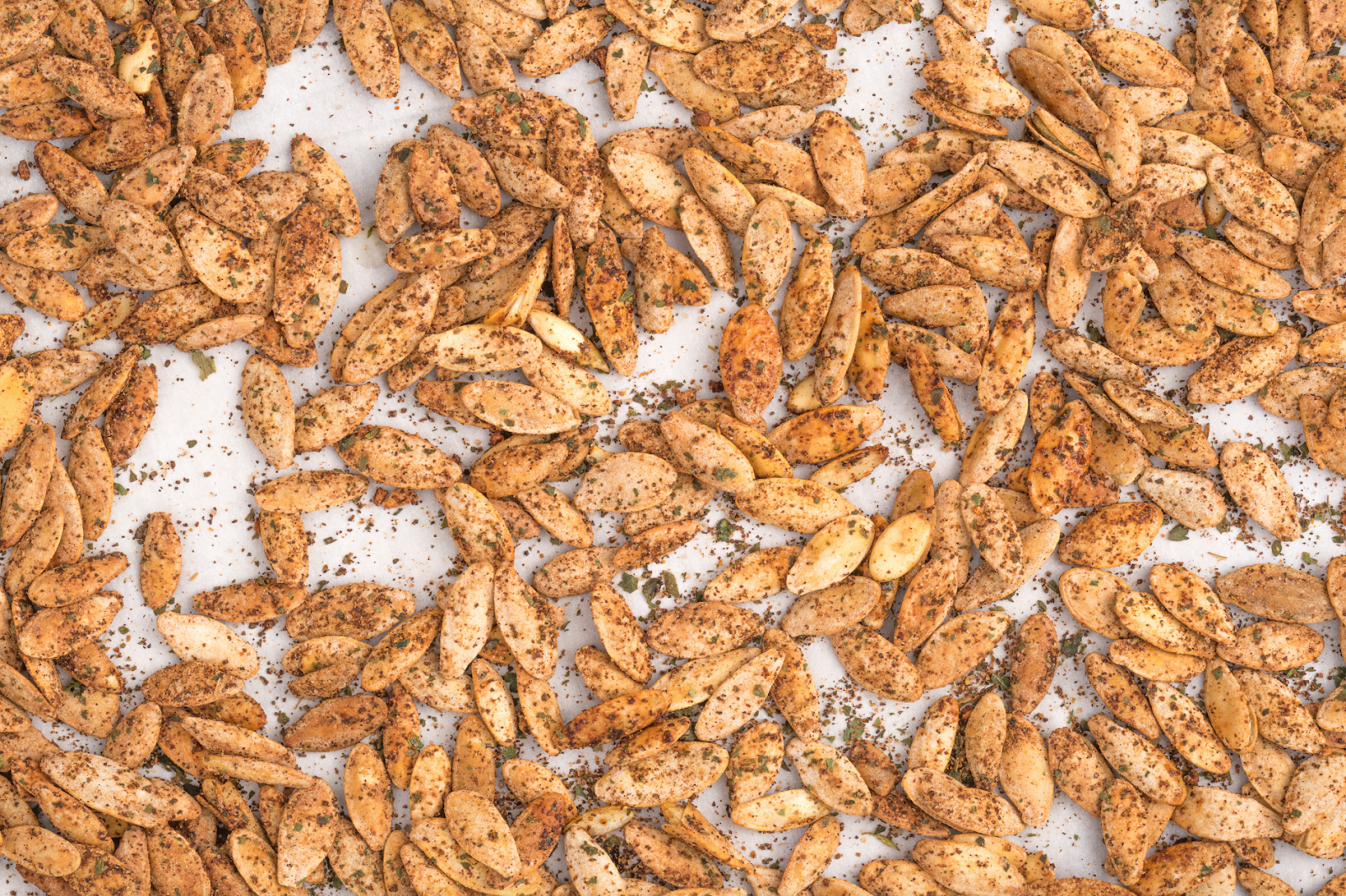 Taco-Lime Pumpkin Seeds  - Delish.com this site has more recipes for pumpkin seeds if this doesn't work for you.