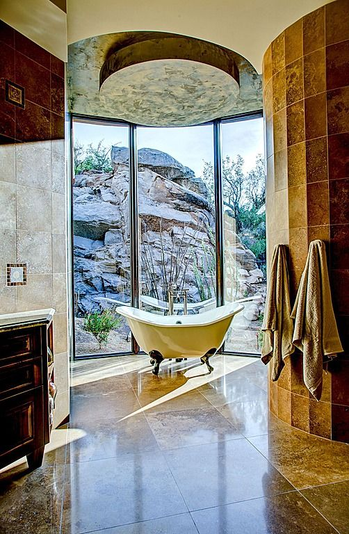 Exterior window walls provide an intimate view of the canyon during ...