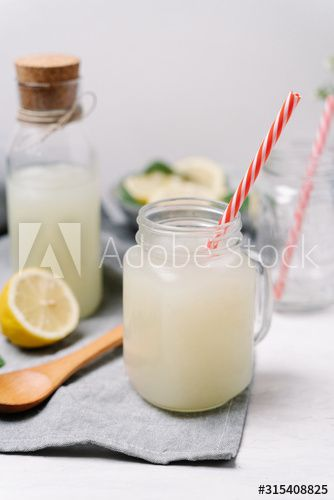 Taste lemonades in stylish tumblers with colorful plastic tubes serving on wooden slice and decorated squeezed lemons on blurred background , #spon, #colorful, #plastic, #tubes, #tumblers, #Taste #Ad