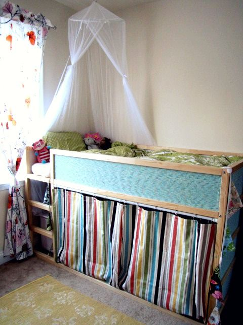 Love the cozy nook underneath that could even be another sleeping spot.  Could work as a toddler/preschooler bed.