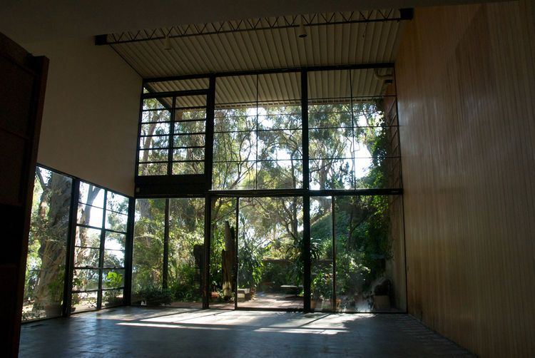 """#Eames House: """"Just as in Japan's old teahouses, after 200 years of simply putting a cup in the same place, there's very subtle wear that develops,"""" says Demetrios. """"This house has that same feeling."""" At right one can make out a dark square where the couple's Franz Kli"""