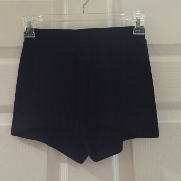 Black stretchy shorts Black stretch shorts with ribbed sides and zipper back. 74% rayon 23% polyester 3% spandex Charlotte Russe Shorts