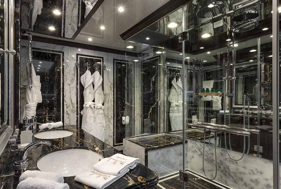 Unique Bathroom Design In Black Marble With A Glass Shower