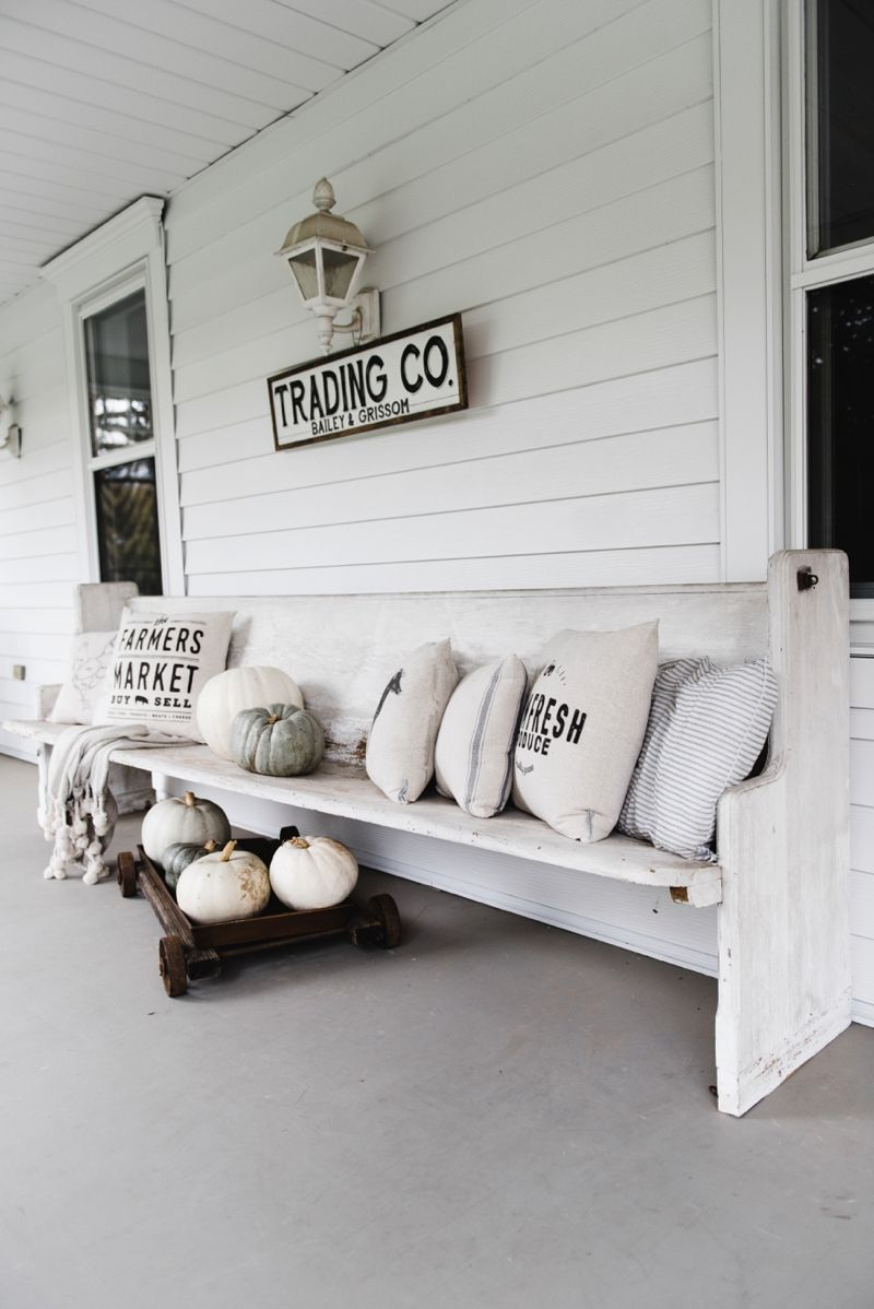 Farmhouse style porch Church pew and