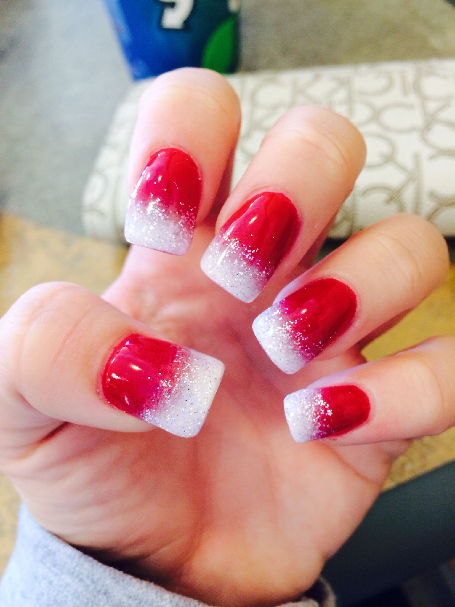 red nails with white ombr and sparkle at the tip