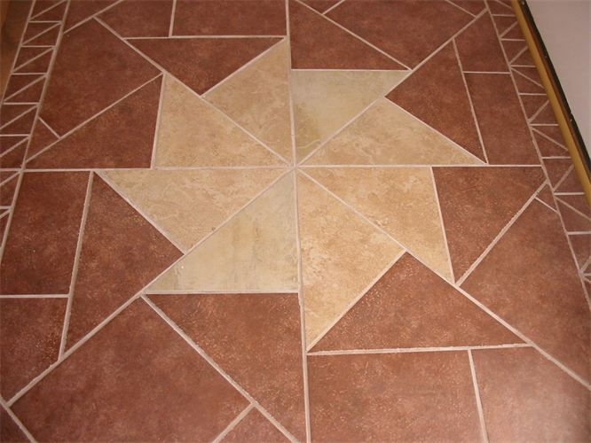 foyer starburst design tiles were custom cut to create this
