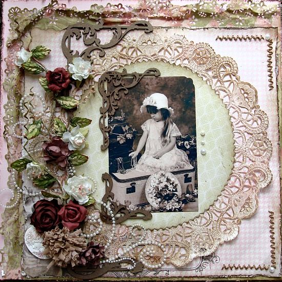 Gorgeous vintage style girl's page with circular lace framing embellished with dimensional flowers and machine stitched borders.