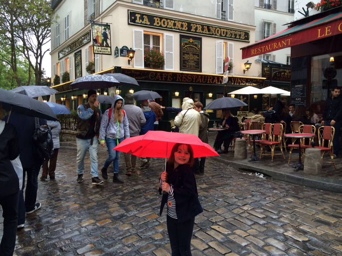A Rainy Day In Paris With Her Red Umbrella