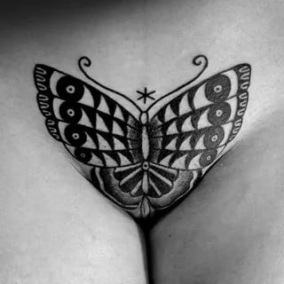 Butterfly crotch tattoo