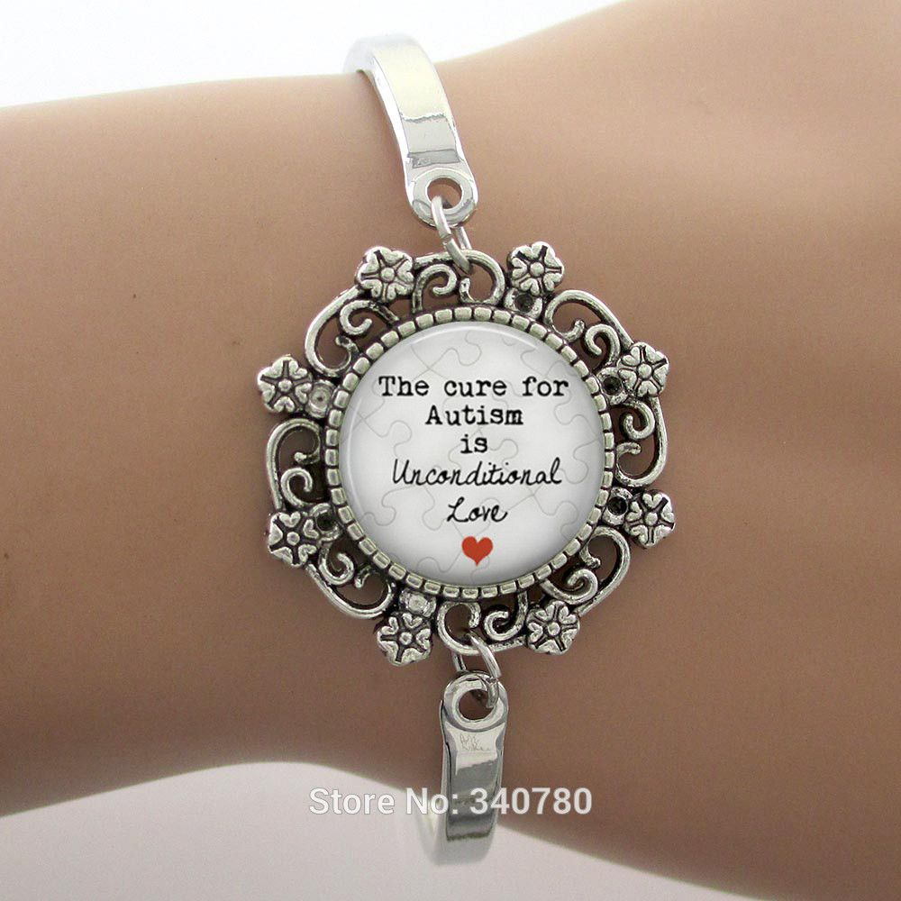 The cure for autism is unconditional love glass dome lace charm