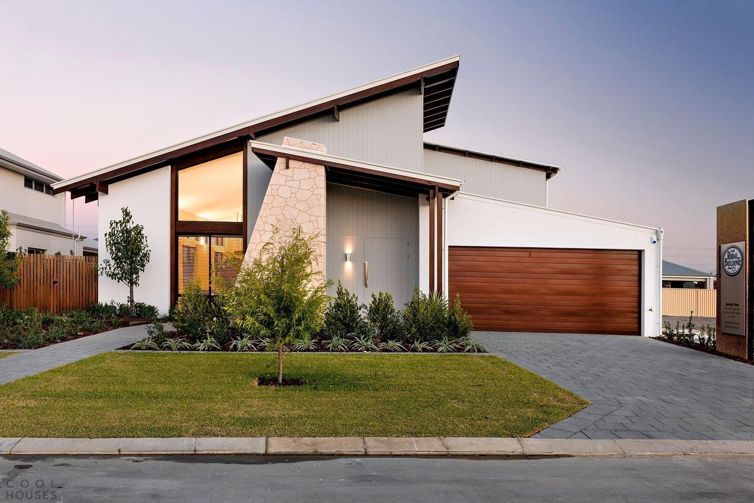 Gray Concrete Brick Driveway Design Towards The Garage