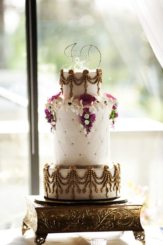 """This cake is all fondant with gumpaste flowers.  Middle tier is over ten inches tall. Pearls were made with a mold and painted gold.  The picture isn't that great so I'll add the """"fridge"""" pic as well. LolI just added some of the professional shots....you can see the difference, my camera isn't that great."""