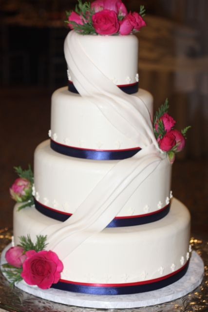 navy blue and hot pink wedding cake pink flowers for a winter wedding mmmmm wedding 17751
