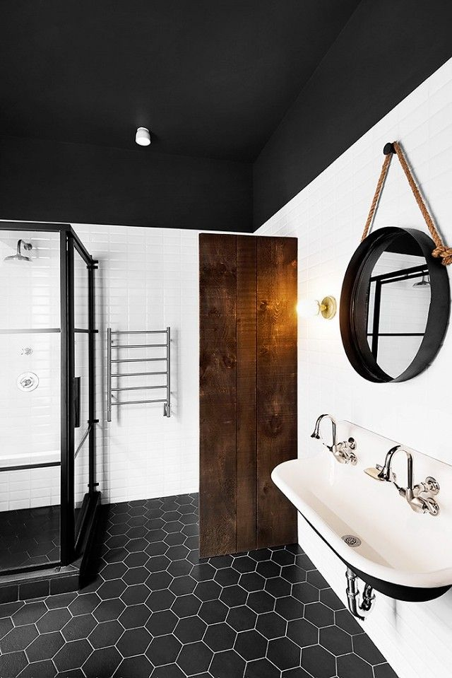 A large hanging mirror gives this bathroom a well-rounded appeal, adding a casual, laid-back element to an otherwise minimalist space.