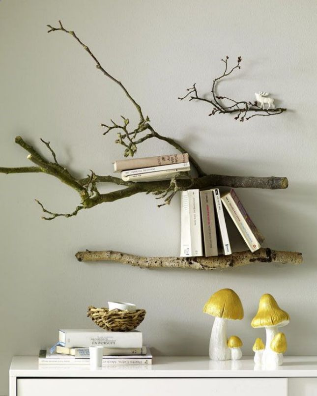 This branch book shelf is an awesome way to incorporate tree branch decor.  Secure branches to the wall with nails and float a few books on top for a  ...