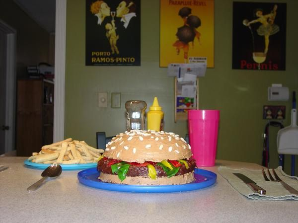 Cheeseburger cake with brownie patty.  Fruit roll-ups for condiments and sugar cookie french fries. Yum!