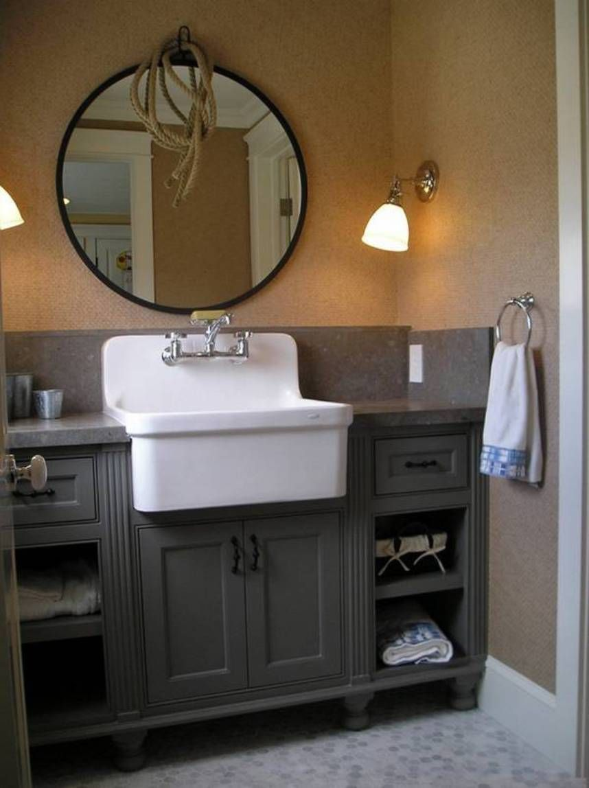 Antique Bathroom Vanity With Farmhouse Style Sink And Round Mirror