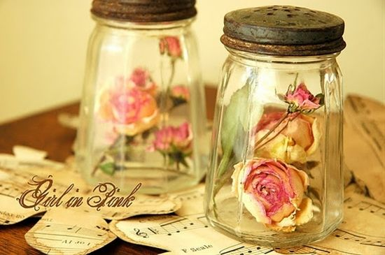 rose buds in old salt and pepper shakers...