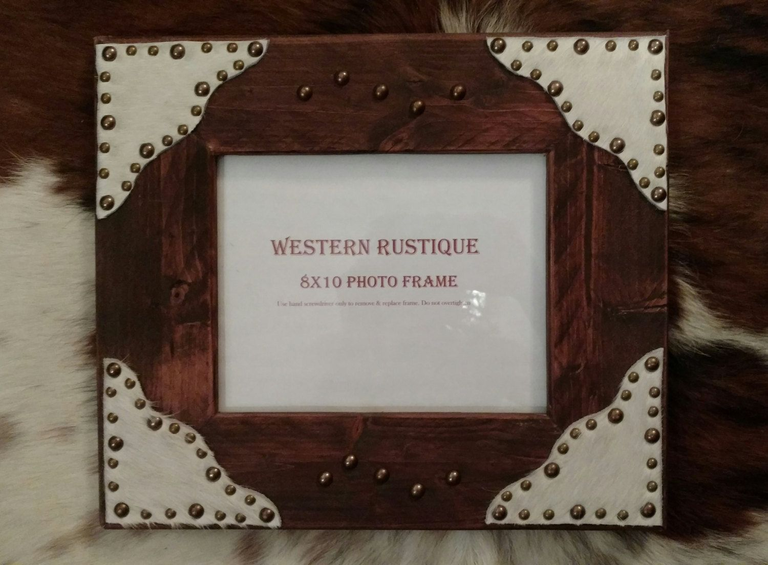 Western décor 8x10 Photo Frame Red Oak with White Hair on Hide Scallop s accented with Copper Rivets by WesternRustique on Etsy