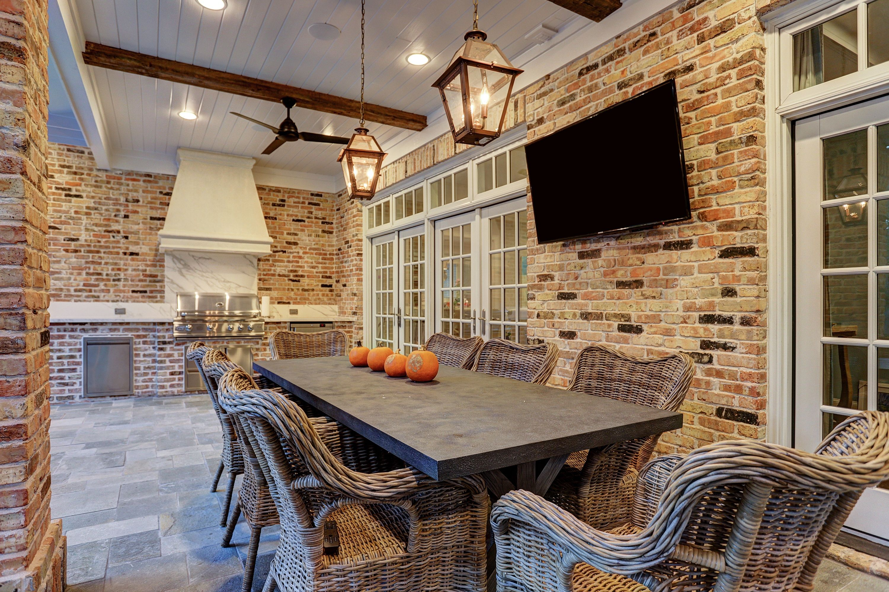 outdoor living room with kitchen area and custom vent hood outdoor living patio design on outdoor kitchen and living space id=93447