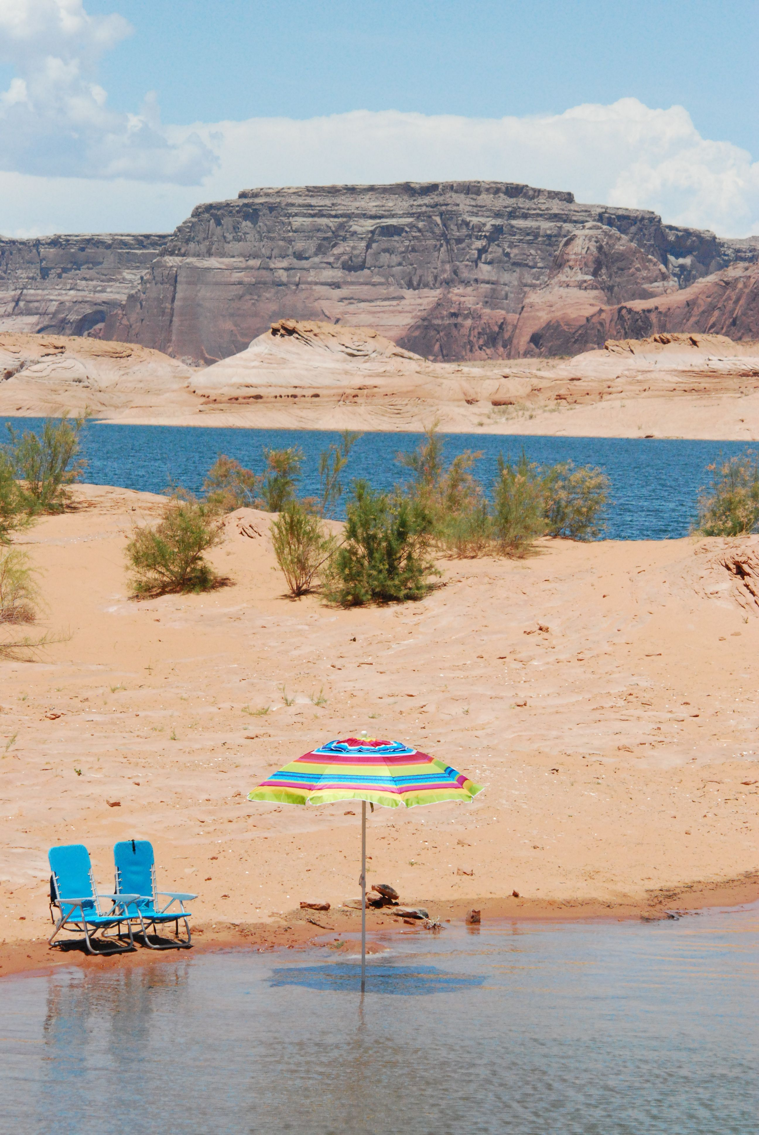 Lake Powell is a reservoir on the Colorado River, straddling the border between Utah and Arizona. It is a major vacation spot that around 2 million people visit every year. Wikipedia
