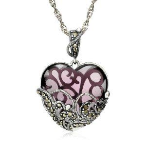 I actually have this necklace, I got it last christmas :) It's very pretty!